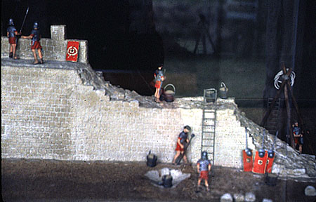 Model of legionary soldiers building Hadrian's wall modern.