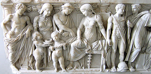 the gifts are given to the children by a seated Medea as Jason, the Nurse,